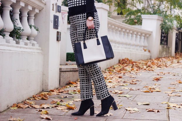 Laura Ashley archive print trousers, Studio Nicholson coat, See by Chloe boots, Chanel sunglasses, Prada bag
