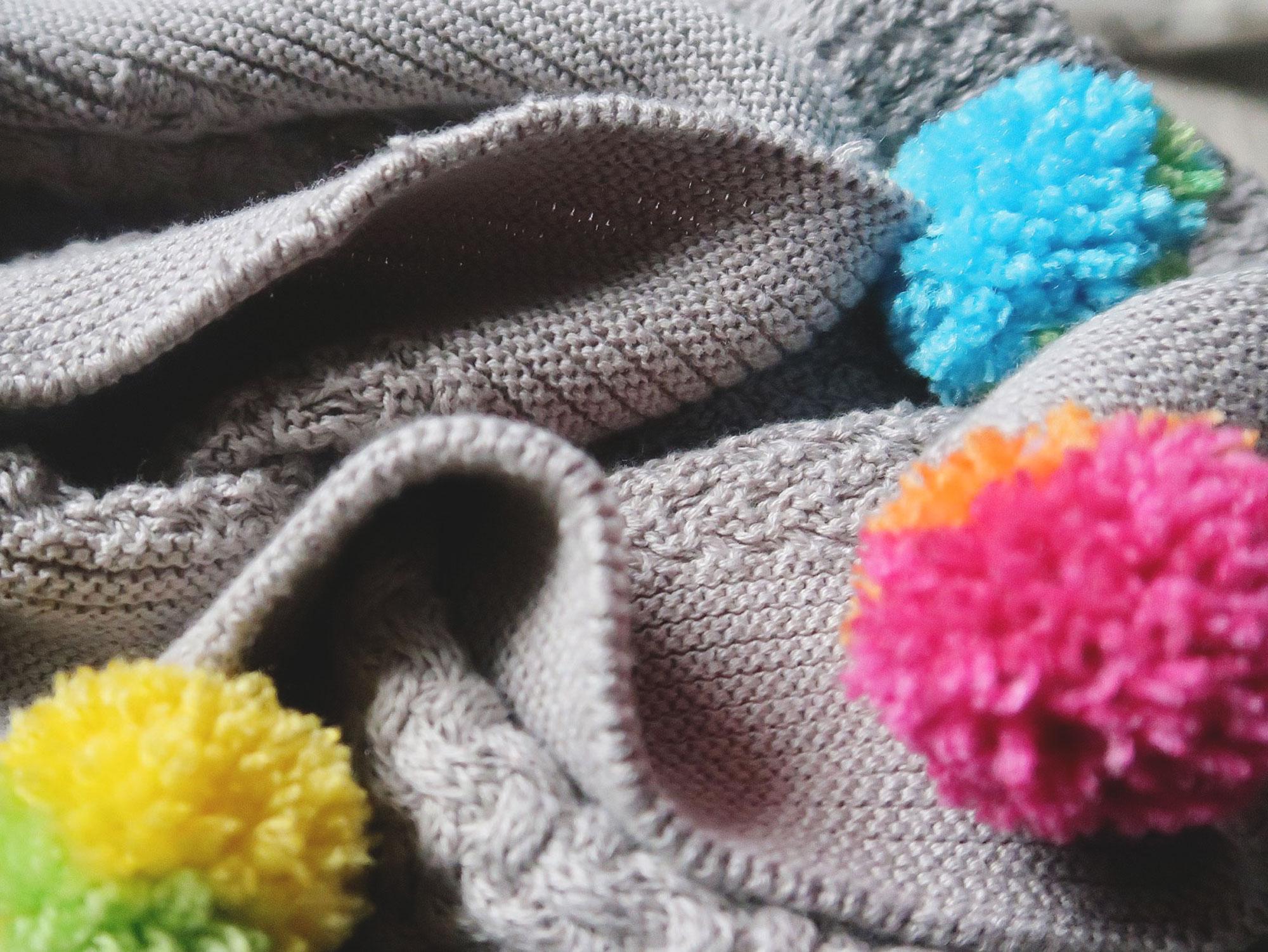 pom_pom_making_blanket_close_up