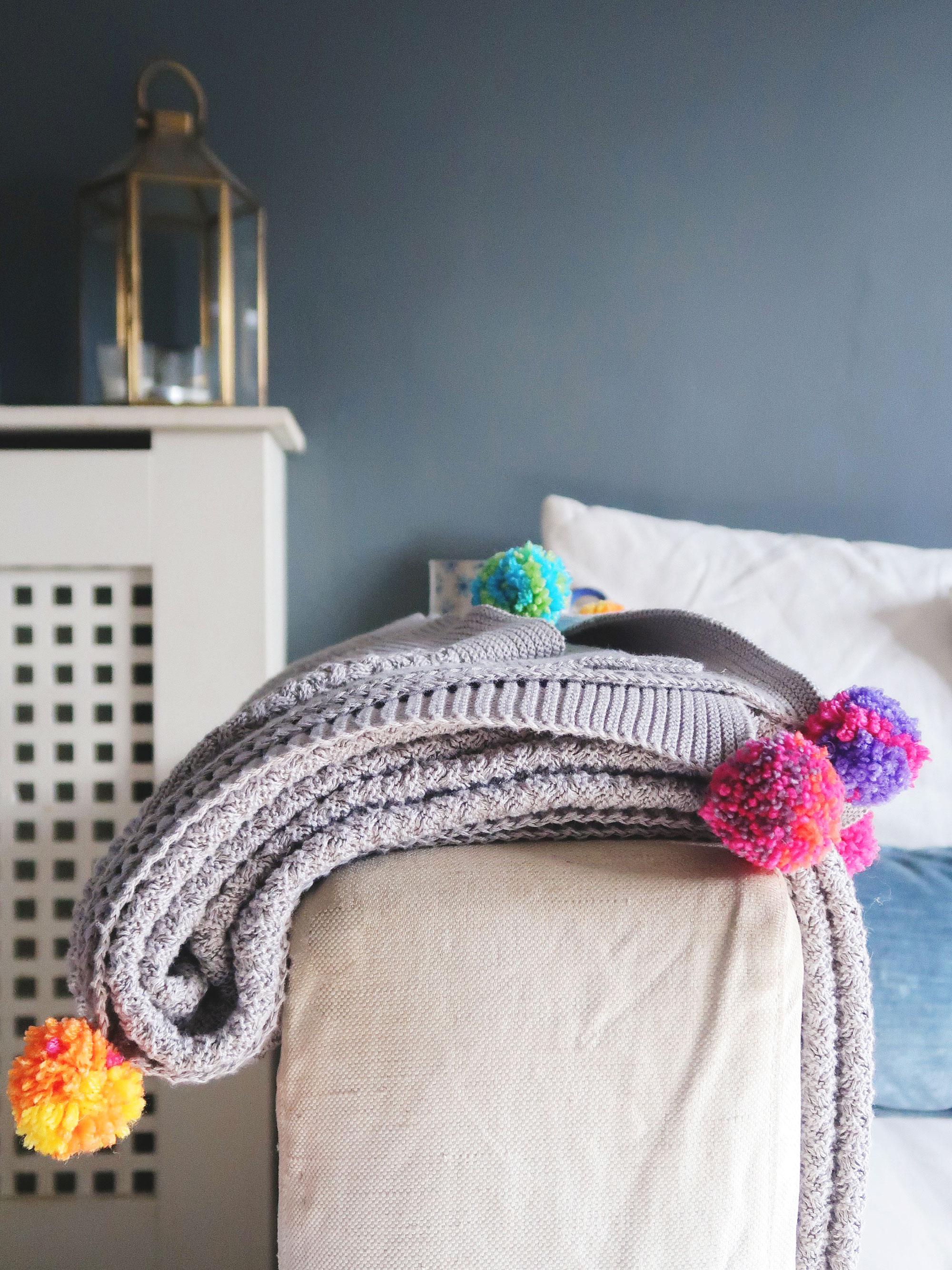pom_pom_making_finished_blanket