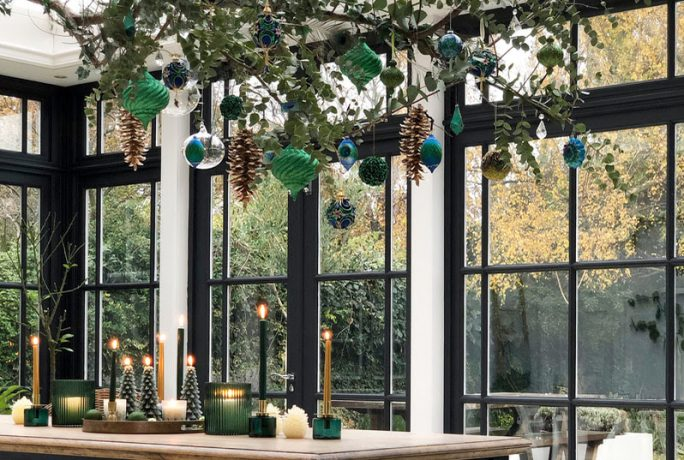 Decorate your Christmas table with a hanging branch centrepiece
